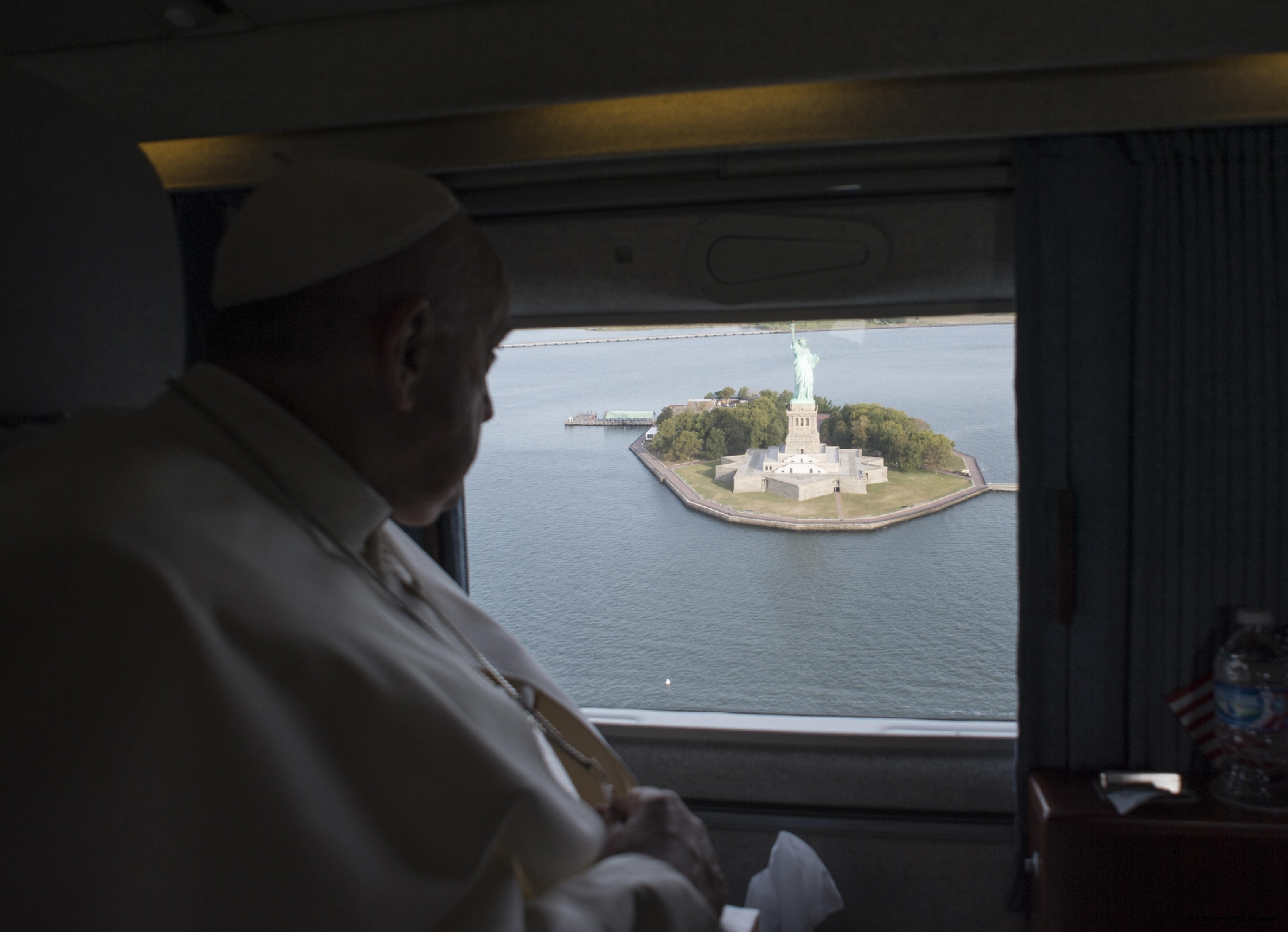 Pope Francis looks at the Statue of Liberty from the window of the helicopter on his way to the John F. Kennedy International Airport