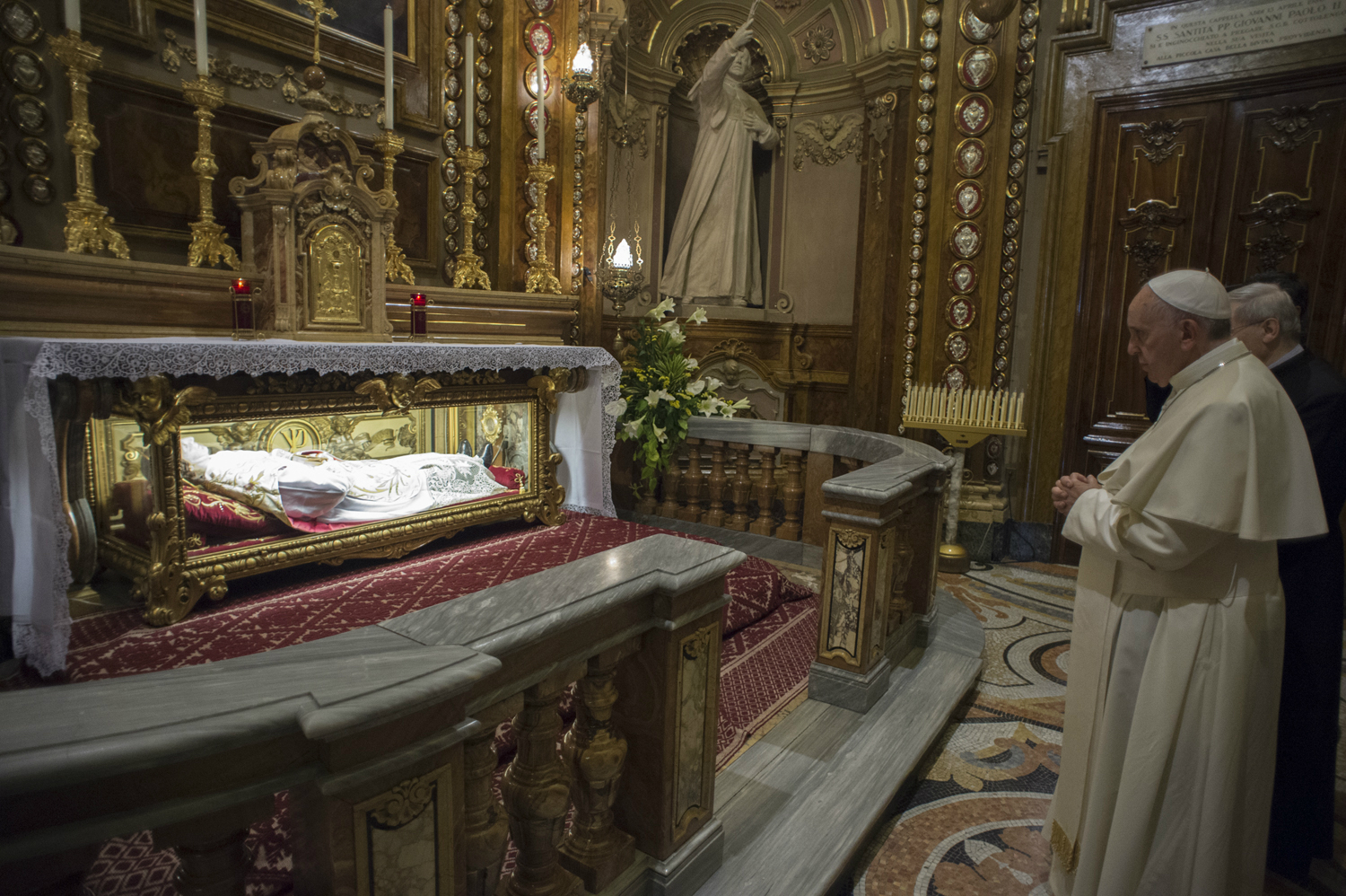 Pope Francis at the tomb of Saint Don Bosco