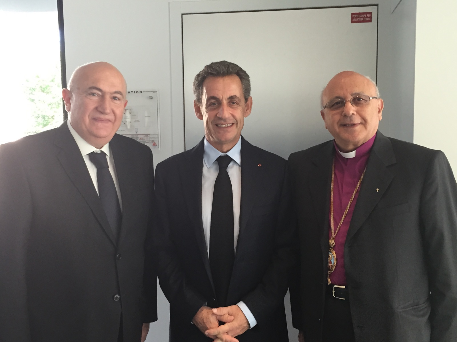 Lebanese bishop John Issam Darwish meets former French president Nicolas Sarkozy