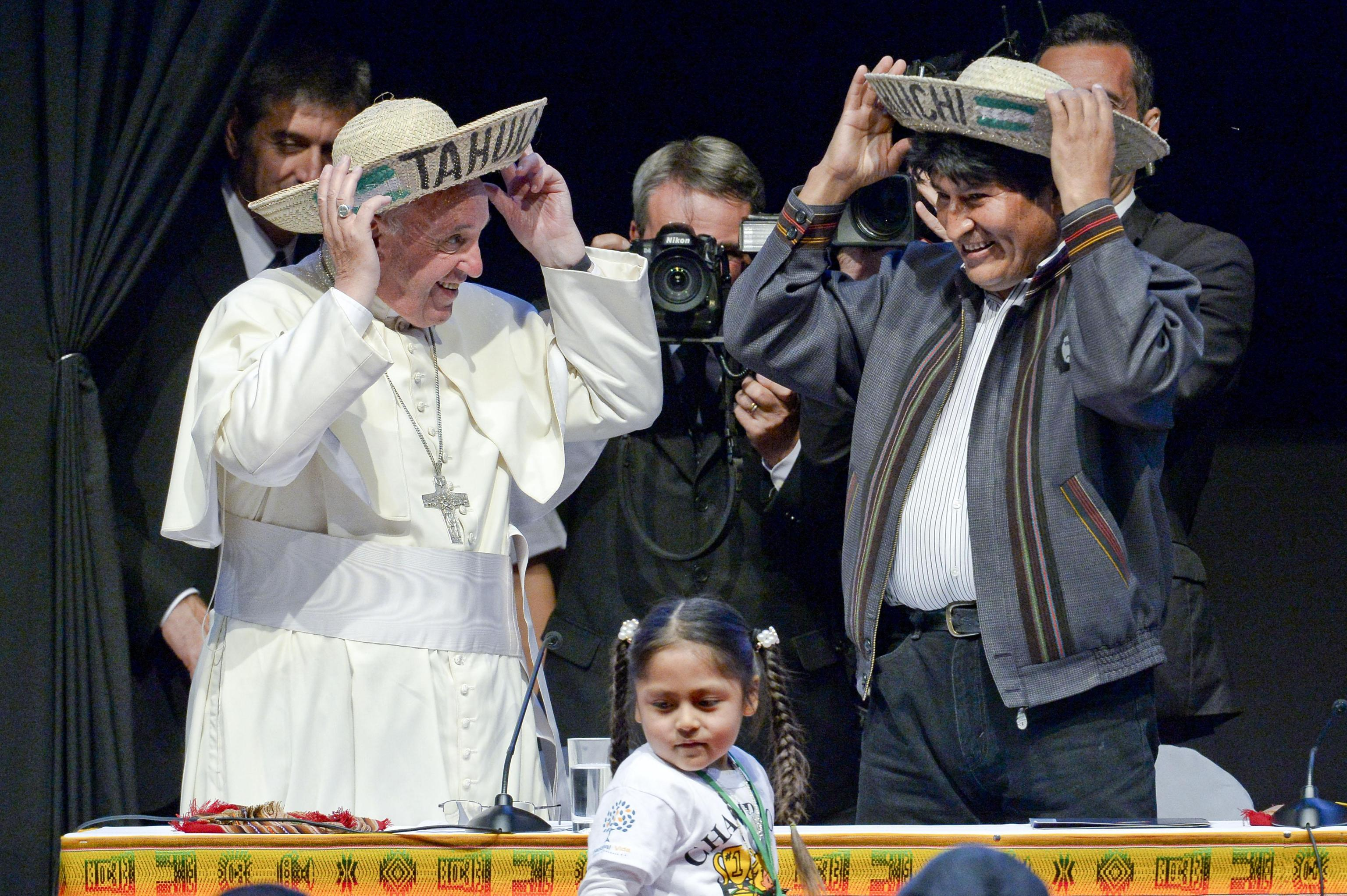 Pope Francis and Bolivian President Evo Morales wearing traditional hats from the region of Santa Cruz