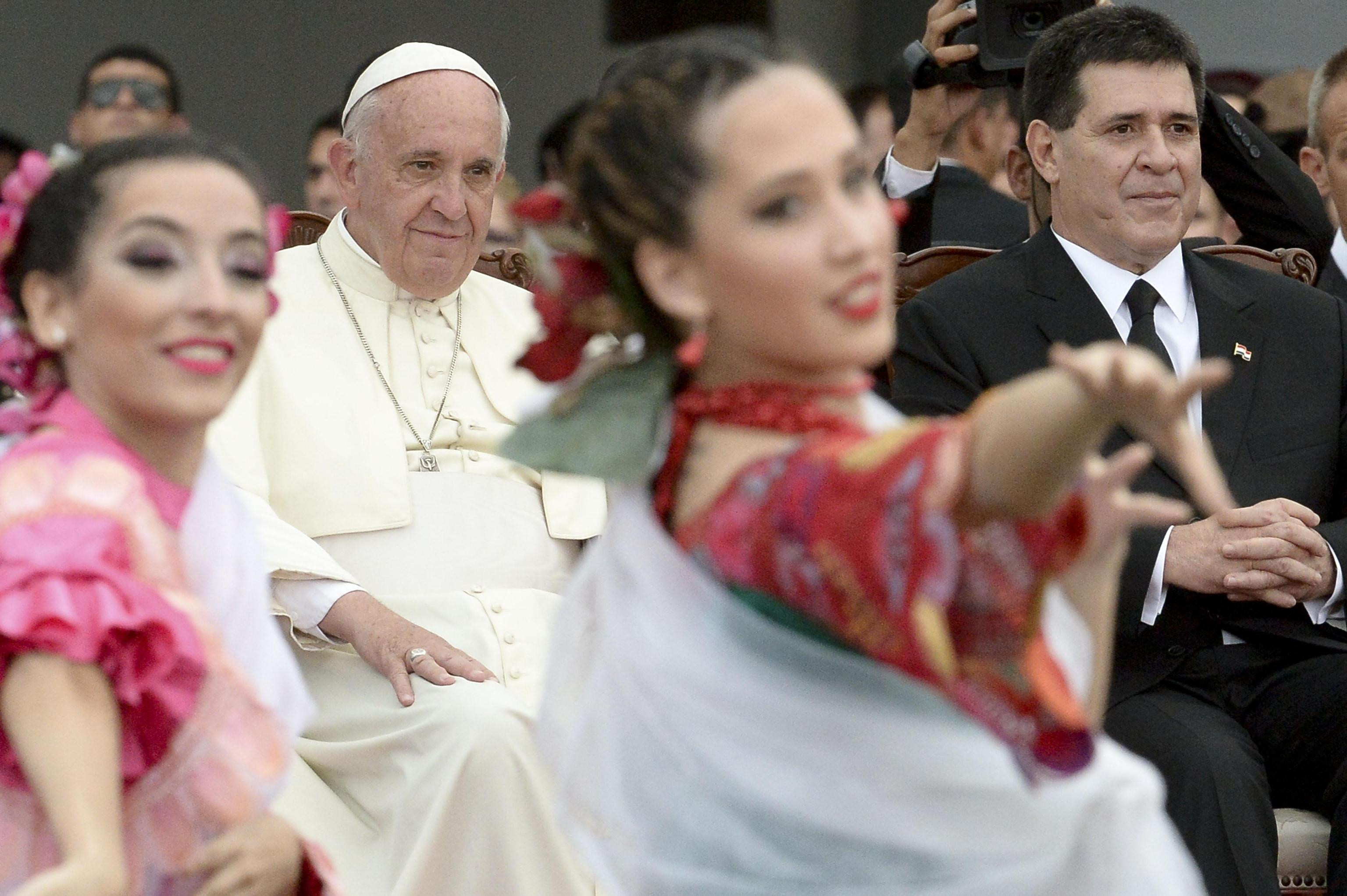 Pope Francis and Paraguay's President Horacio Cartes attend welcome ceremony at the Silvio Pettirossi International airport in Asuncion