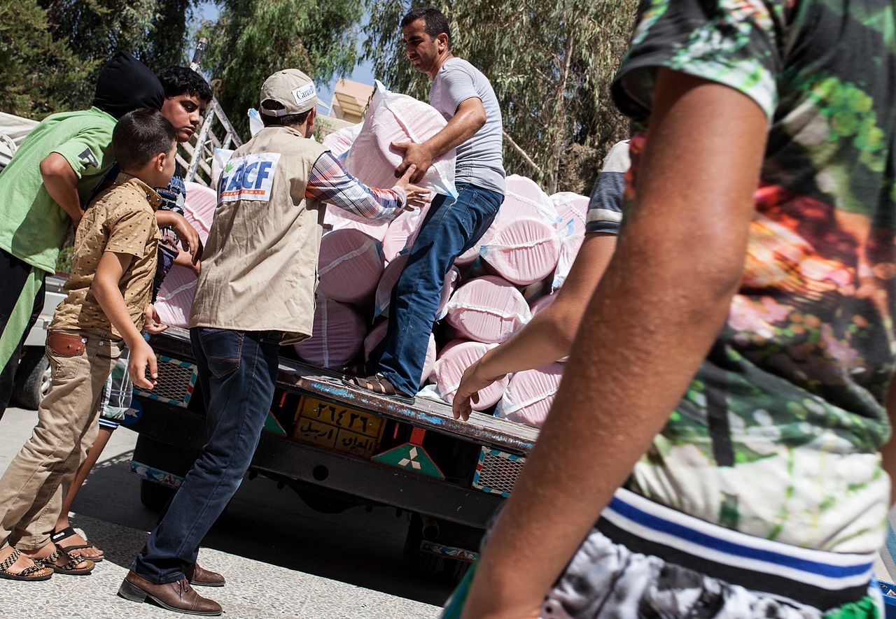 Action Against Hunger team deliver hygiene kits to Iraqi refugees