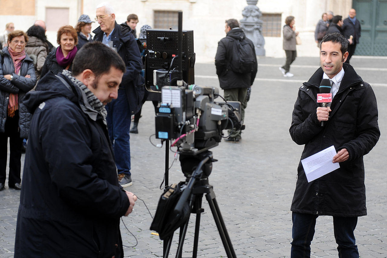 RAI journalist during a direct transmission from Piazza di Montecitorio