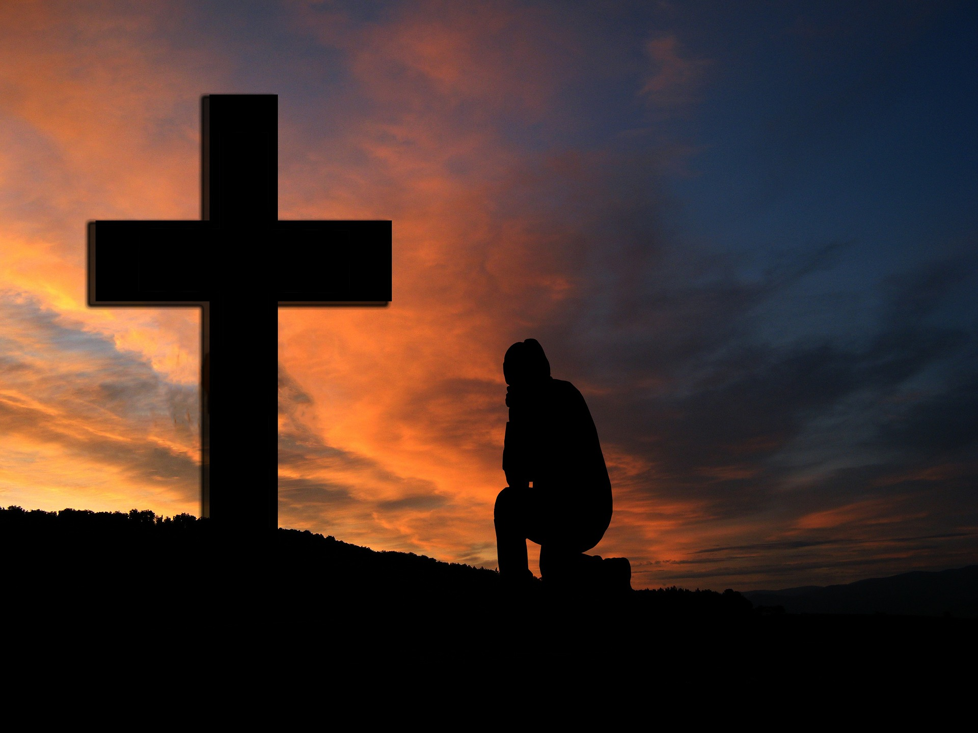 Praying in front of the Cross
